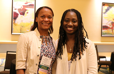 Two smiling nurses at a recent AAACN conference.